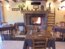 La salle du Restaurant avec la cheminé